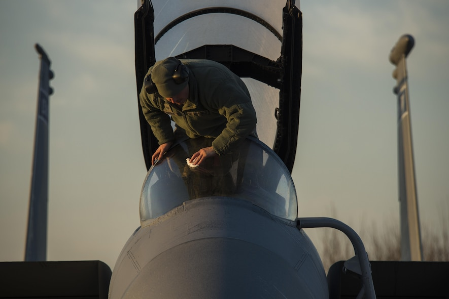 Staff Sgt. Joshua Matrine, 159th Aircraft Maintenance Squadron crew chief, cleans the canopy on a F-15C Eagle from the Louisiana Air National Guard at Leeuwarden Air Base, Netherlands, March 28, 2017. The 122nd Expeditionary Fighter Squadron, comprised of Louisiana and Florida Air National Guard members, will conduct training alongside NATO allies to strengthen interoperability and demonstrate U.S. commitment to the security and stability of Europe. (U.S. Air Force photo by Staff Sgt. Jonathan Snyder)