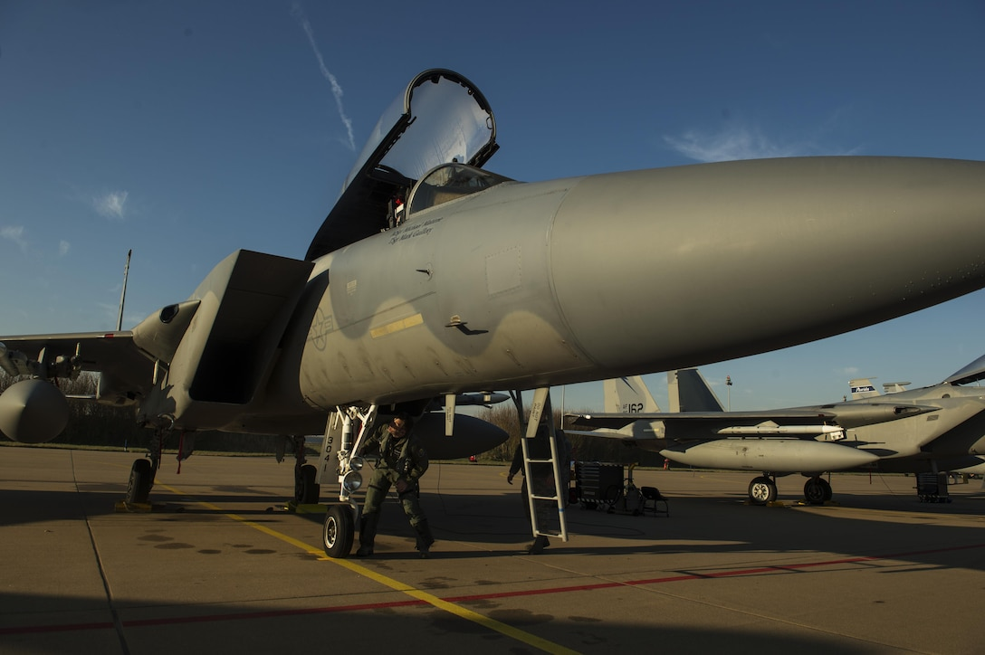 Maj. Joshua Higgins, 122nd Expeditionary Fighter Squadron pilot, conducts a pre-flight inspection on a F-15C Eagle at Leeuwarden Air Base, Netherlands, March 28, 2017. The 122nd Expeditionary Fighter Squadron, comprised of Louisiana and Florida Air National Guard aircraft, will conduct training alongside NATO allies to strengthen interoperability and demonstrate U.S. commitment to the security and stability of Europe. (U.S. Air Force photo by Staff Sgt. Jonathan Snyder)