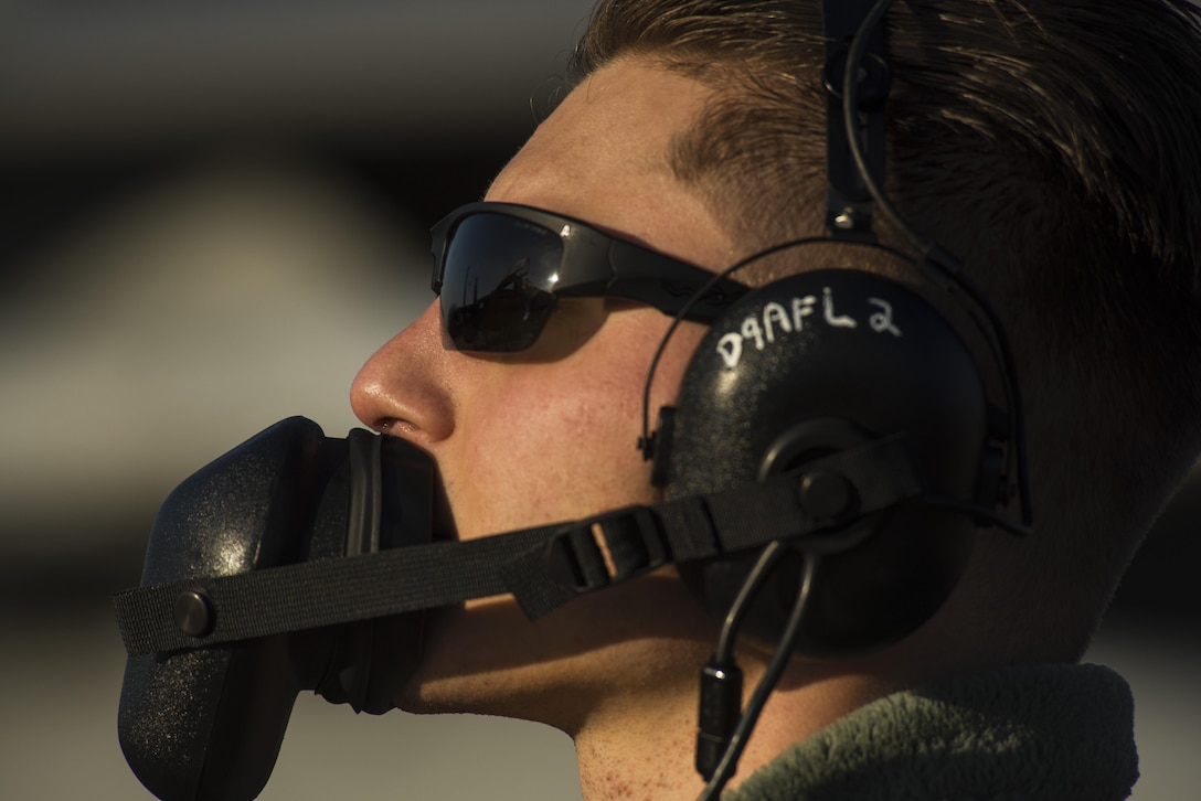 Airman 1st Class Josh Herzog, 159th Aircraft Maintenance Squadron crew chief, communicates with the pilot while conducting a pre-flight inspection on a F-15C Eagle at Leeuwarden Air Base, Netherlands, March 28, 2017. The 122nd Expeditionary Fighter Squadron, comprised of Louisiana and Florida Air National Guard aircraft, deployed to Europe to participate as a Theater Security Package. These F-15s will conduct training alongside NATO allies to strengthen interoperability and to demonstrate U.S. commitment to the security and stability of Europe. (U.S. Air Force photo by Staff Sgt. Jonathan Snyder)