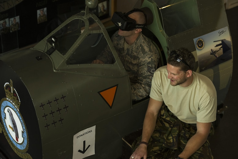 Staff Sgt. Geremy Stovall, left, 159th Maintenance Squadron aerospace reclamation technician, listens to instructions from Royal Netherlands air force Sgt. 1st Class Robbert Kwantes, right, 322nd Squadron crew chief, while piloting their Spitfire flight simulator during an ice breaker social event at Leeuwarden Air Base, Netherlands, March 28, 2017. The U.S. Air Force deployed approximately 300 Airmen along with 12 F-15Cs to Europe as a part of a Theater Security Package in support of Operation Atlantic Resolve. While in theater these aircraft will participate in Royal Netherlands Air Force-led exercise, Frisian Flag, and will then forward deploy to European NATO nations for approximately six months. (U.S. Air Force photo by Staff Sgt. Jonathan Snyder)