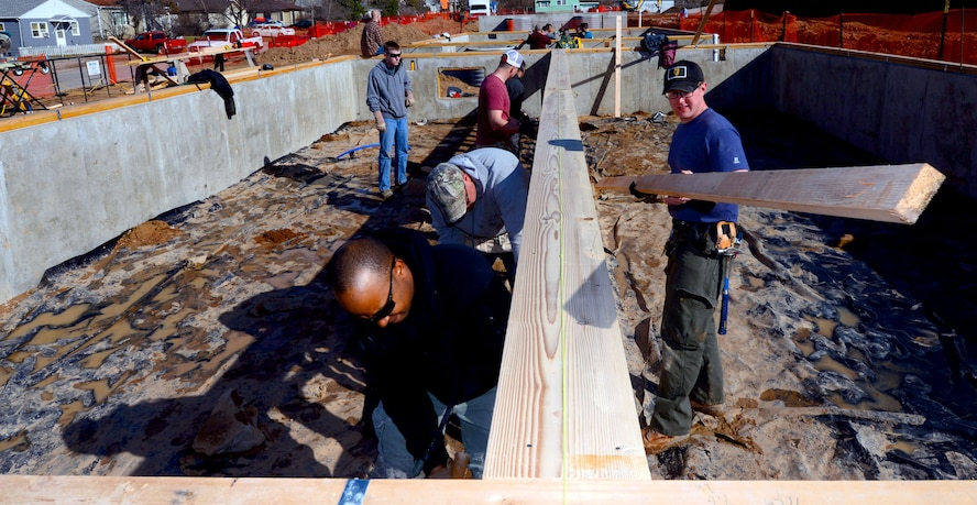 Members of the 28th Civil Engineer Squadron finish installing low-barring walls in a Habitat for Humanity home in Rapid City, S.D., March 23, 2017. During the build, members of the 28th CES were able to participate as a team and enhance their construction skills for use while deployed. (U.S. Air Force photo by Airman 1st Class Donald C. Knechtel)