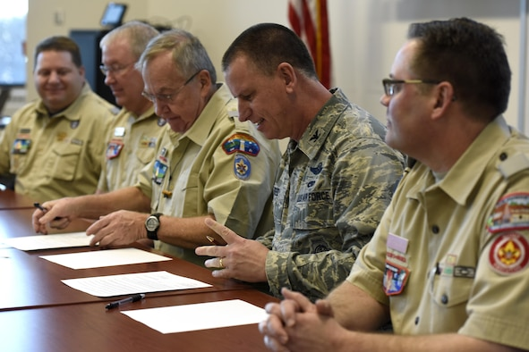 U.S. Air Force Col. Scott Reed, vice wing commander of the 180th Fighter Wing, Ohio Air National Guard, reviews a Memorandum of Understanding between the 180FW and the Boy Scouts of America's Erie Shores Council. The MOU with the Erie Shores Council provides a diverse leadership model to local Boy Scouts through exposure to 180FW Airmen and leaders, fostering a spirit of citizenship and civic responsibility while increasing event support, enhancing training opportunities and building stronger community relationships. (U.S. Air National Guard photo by Staff Sgt. Shane Hughes)