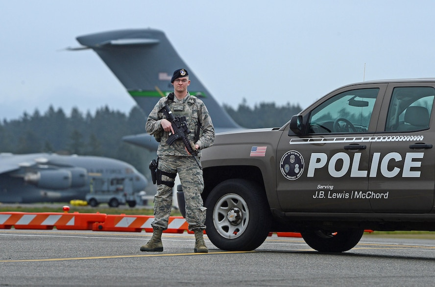 Airman 1st Class Jonathan Hailey, 627th Security Forces Squadron patrolman, stands guard on the McChord Field flightline Mar. 28, 2017 at Joint Base Lewis-McChord, Wash. Armed and trained Airmen from the 627th SFS answer the call of duty every day to ensure the McChord Field flightline is secure at all times by patrolling it with vigilance. (U.S. Air Force photo/Senior Airman Divine Cox)
