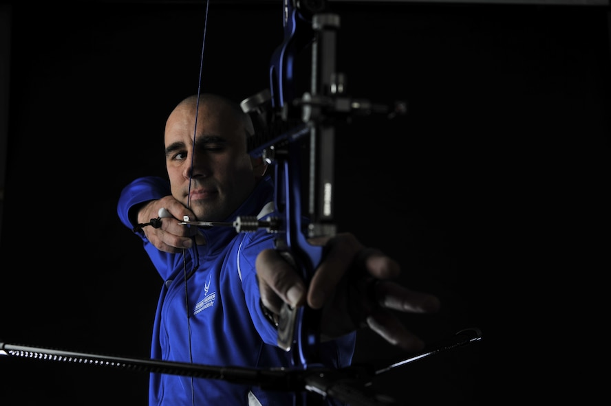U.S. Air Force Tech. Sgt. Michael Christiansen, 100th Security Forces Squadron assistant flight chief, draws back a bow and arrow March 28, 2017, on RAF Mildenhall, England. Christiansen is the only U.S. Air Forces in Europe Airman to qualify at the 2017 Warrior Games Air Force Trials in Nellis Air Force Base, Nev., and will represent at the 2017 Department of Defense Warrior Games in Chicago. (U.S. Air Force photo by Staff Sgt. Micaiah Anthony)