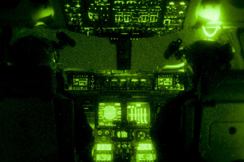 Captain Andrew Rast (left) and Lt. Col. J.W. Smith (right), 304th Expeditionary Airlift Squadron C-17 pilots, prepare to land a C-17 using night vision goggles on Pegasus Ice Runway near McMurdo Station, Antarctica July 15, 2016. Antarctica is the coldest, windiest, most inhospitable continent on the globe, and each trip to Antarctica requires careful planning and coordination. Operation Deep Freeze's new year-round operating seating opens doors for additional science and research to be conducted in support of the National Science Foundation-managed U.S.