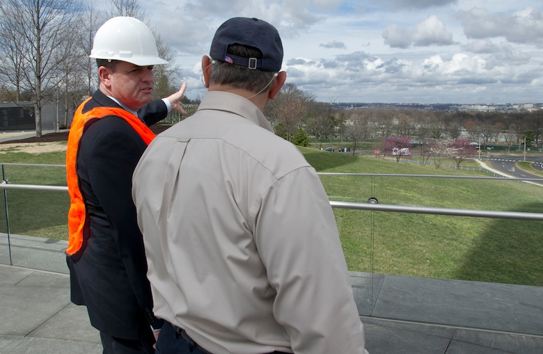 Peter Vielandi (left), Air Force District of Washington, and Sam Hunt, Air Force Memorial facility manager, discuss upcoming developments to the grounds surrounding the U.S. Air Force Memorial March 28, 2017 in Arlington, Va. In April 2017, the Air Force Memorial Foundation will hand off day-to-day operational responsibilities to AFDW. (U.S. Air Force photo by Staff Sgt. Joe Yanik)