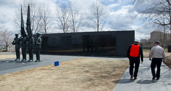 Peter Vielandi (left), Air Force District of Washington, and Sam Hunt, Air Force Memorial facility manager, walk past statues portraying Airmen from the U.S. Air Force Honor Guard March 28, 2017 at the U.S. Air Force Memorial in Arlington, Virginia. The Air Force Memorial Foundation, which dedicated the Memorial to the U.S. Air Force as a gift in 2006, has since maintained the memorial grounds and managed day-to-day operations.  (U.S. Air Force photo by Staff Sgt. Joe Yanik)
