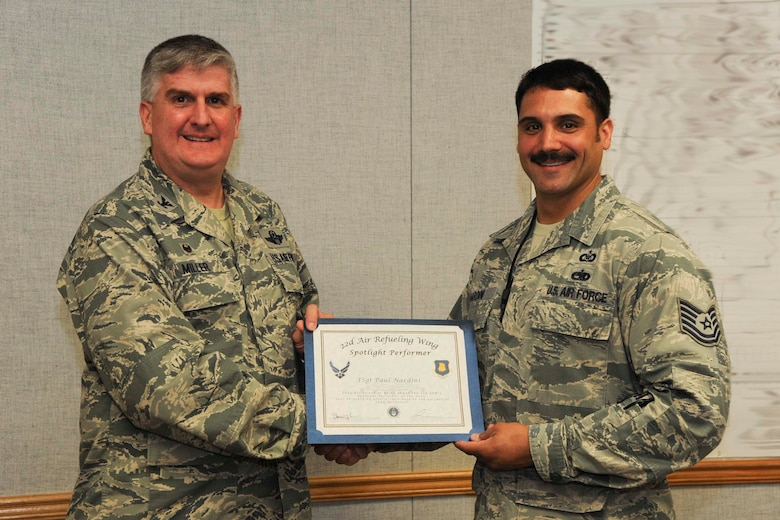 Tech. Sgt. Paul Nardini, 22nd Air Refueling Wing command and control procedures instructor,  poses with Col. Albert Miller, 22nd Air Refueling Wing commander, March 28, 2017, at McConnell Air Force Base, Kan. Nardini received the spotlight performer for the week of March 13–17. This photo has been edited for security purposes. (U.S. Air Force photo/Airman 1st Class Jenna K. Caldwell)