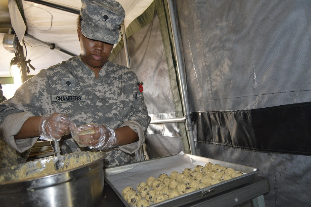 U.S. Army Reserve Spc. Christen Chambers, a food operations specialist assigned to the 1002nd Quartermaster Company in Beaumont, Texas, prepares cookie dough for baking during the Philip A. Connelly cooking competition held at Fort Polk, Louisiana, March 25, 2017. During the Philip A. Connelly Program, the U.S. Army Reserve partners with the National Restaurant Association to give food service personnel an opportunity to demonstrate their capability and combat-readiness while competing for recognition. (U.S. Army Reserve photo by Master Sgt. Dave Thompson)