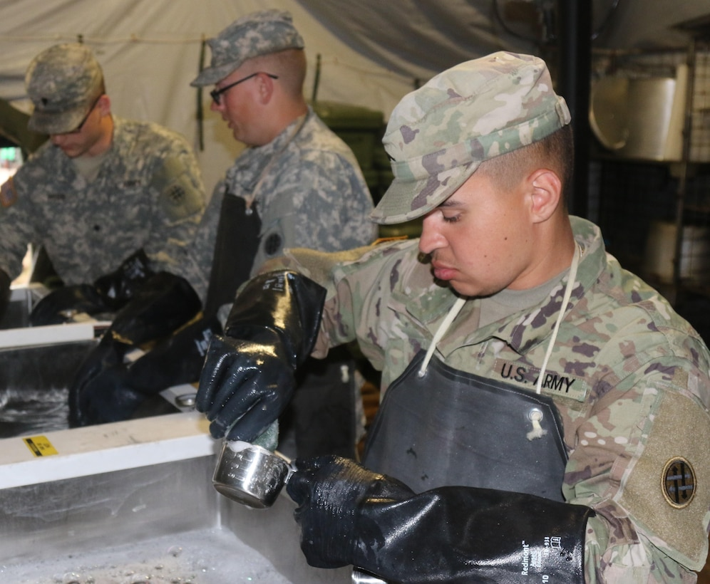 U.S. Army Reserve Pvt. 2nd Class Richard Diaz, a Petroleum Supply Specialist with the 1002nd Quartermaster Company based in Beaumont, Texas, sanitize cookware during the unit's Philip A. Connelly Awards Program evaluation at Fort Polk, LA on Mar. 25, 2017.  During the Philip A. Connelly Program, the U.S. Army Reserve partners with the National Restaurant Association to give food service personnel an opportunity to demonstrate their capability and combat-readiness while competing for recognition. (U.S. Army Reserve photo by Maj. Brandon R. Mace)