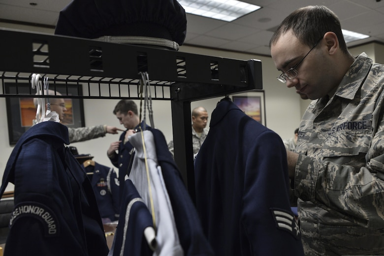 Senior Airman Jared, 41st Intelligence Squadron, adjusts his ribbons for a uniform inspection during Base Honor Guard training Jan. 10 at Fort George G. Meade. (U.S. Air Force photo/Staff Sgt. Alexandre Montes)