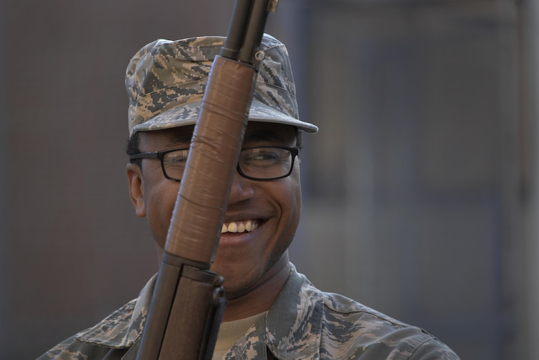 Airman 1st Class Michael, 29th Intelligence Squadron, laughs at the end of Base Honor Guard rifle movements training Mar. 2 at Fort George G. Meade.  (U.S. Air Force photo/Staff Sgt. Alexandre Montes)