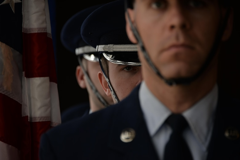 70th Intelligence, Surveillance and Reconnaissance Wing Base Honor Guard Airmen wait for the signal to begin the color presentation for a retirement ceremony Feb.24 at Fort George G. Meade. (U.S. Air Force photo/Staff Sgt. Alexandre Montes)