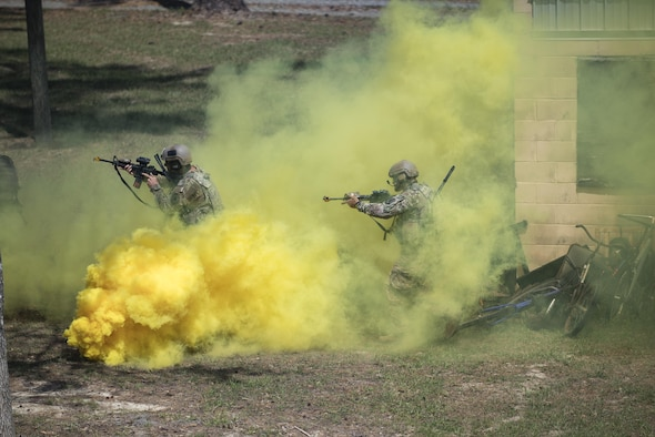 Airmen from the 822d Base Defense Squadron conduct a tactical demo during the 820th Base Defense Group's 20th Anniversary Ceremony, March 28, 2017, at Moody Air Force Base, Ga. Retired chief of staff Gen. John Jumper and his wife, Ellen, and many former members of the 820th BDG visited to celebrate the anniversary. (U.S. Air Force photo by Airman 1st Class Daniel Snider)