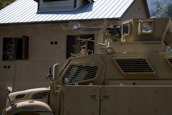 A member of the 822d Base Defense Squadron fires off the M2 Browning .50 caliber machine gun attached to the top of a mine-resistant, ambush-protected vehicle during the 820th Base Defense Group's 20th Anniversary Ceremony, March 28, 2017, at Moody Air Force Base, Ga. Retired chief of staff Gen. John Jumper and his wife, Ellen, and many former members of the 820th BDG visited to celebrate the anniversary. (U.S. Air Force photo by Airman 1st Class Daniel Snider)