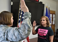 U.S. Air Force Reserve Maj. Polly Orcutt administers the oath of enlistment to Shana Peacock here, March 24. Peacock enlisted to become a loadmaster with the 757th Airlift Squadron, and is preparing for basic training. For information on joining the Air Force Reserve, visit www.afreserve.com. (U.S. Air Force photo/Eric White)
