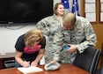 U.S. Air Force Reserve Master Sgt. Joseph Poltor, a recruiter with the 910th Airlift Wing here, helps Shana Peacock fill out paperwork after taking the oath of enlistment, March 24. Peacock enlisted to become a loadmaster with the 757th Airlift Squadron, and is preparing for basic training. For information on joining the Air Force Reserve, visit www.afreserve.com. (U.S. Air Force photo/Eric White)