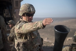 Army Pfc. Gabriel Gomes, assigned to 2nd Battalion, 325th Airborne Infantry Regiment, calls for direction of fire while manning a mortar firing position near Mosul, Iraq, in support of Operation Inherent Resolve, Feb. 28, 2017. Army photo by Staff Sgt. Alex Manne