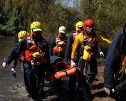 First responders from the Mexican states of Jalisco and Michoacán practice rescuing a victim as part of a week-long water search and rescue training exercise in Puerto Vallarta, Mexico, March 21, 2017. Training included 20 first responders from Mexico, members of the U.S. Public Health Service and interagency coordination specialists from U.S. Northern Command. First responders performed techniques such as how to quickly assess and classify victims in a mass casualty situation, tie rope and webbing, and improvise an anchor on shore if needed to bring a victim to safety. (Photo by U.S. Air Force 1st Lt. Lauren Hill/Released)