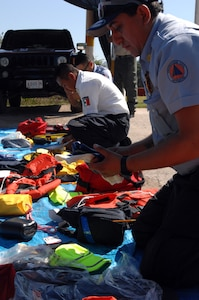 A first responder from the Mexican state of Michoacán's Civil Protection takes inventory of his new equipment donated by U.S. Northern Command in Puerto Vallarta on March 20, 2017. This is part of USNORTHCOM's partnership with Mexico to train and equip Mexican first responders as USNORTHCOM donated $270,000 of water search and rescue gear. (Photo by U.S. Air Force 1st Lt. Lauren Hill/Released)