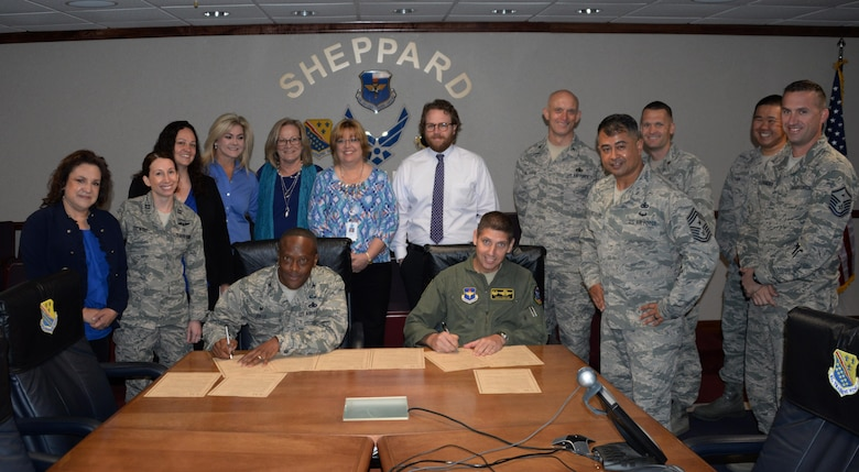 Col. Ronald Jolly, 82nd Training Wing commander and Col. Gregory Keeton, 80th Flying Training Wing commander, support Child Abuse Prevention Month by signing a proclamation March 30, 2017. Throughout the month of April, Family Advocacy and several other agencies will be hosting events to remind Team Sheppard of the resources available to them to help prevent and stop child abuse. (U.S. Air Force photo by Senior Airman Robert L. McIlrath/Released)