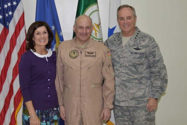 Lt. Col. Richard Rubin, 92nd Aerospace Medicine Squadron flight surgeon, and his wife pose for a photo with Gen. Mark A. Welsh III, former Chief of Staff of the Air Force. Rubin discovered a new syndrome called the vision impairment and intracranial pressure syndrome while working for NASA between 2006 and 2009. (Courtesy photo)