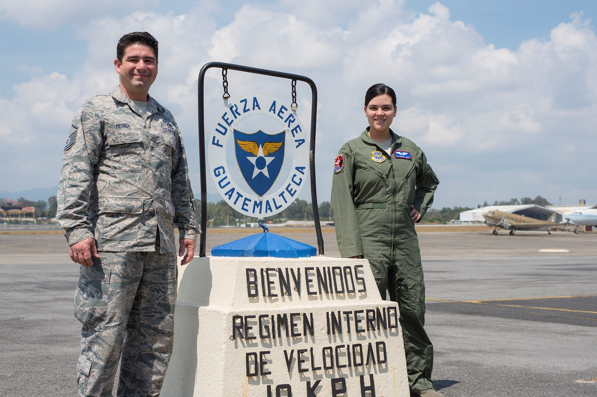 Master Sgt. Alejandro Medina, 571st Mobility Support Advisory Squadron air advisor, takes a picture with his daughter Senior Airman Giannina, sensor operator at Creech AFB, Nevada, during a training mission at La Aurora Air Base, Guatemala.