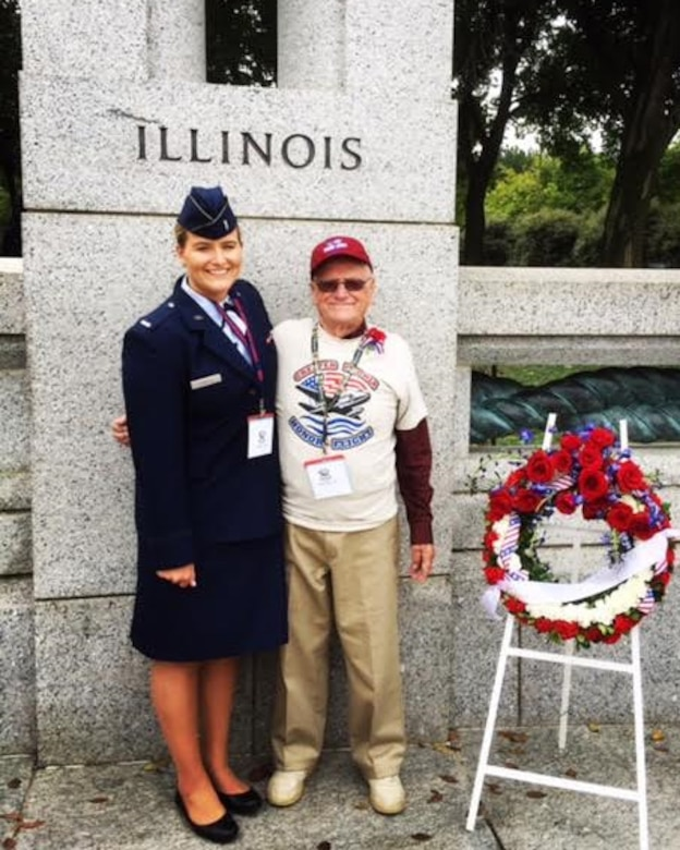 1st Lt. Ashley Christ, 30th Force Support Squadron military personnel section chief, and her grandfather and Korean War veteran, Donald Messner, pose for a photo in front of the National World War II Memorial, Sept. 27, 2016, Washington D.C. (Courtesy Photo)