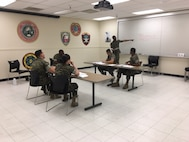 Sergeant Terrance R. Wiley of Headquarters Company, Marine Corps Communication-Electronics School engages the students of the Lance Corporal Leadership and Ethics Seminar Course 2-17. Sergeant Wiley's primary duties are as the Platoon Sergeant for Supply Section in Headquarters Company.