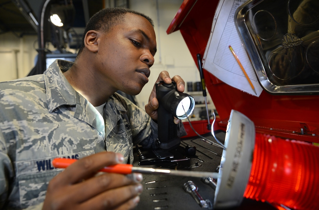 Staff Sgt. Austin Williams, 627th logistics Readiness Squadron vehicle maintenance technician, inspects a strobe light for a deicer March 30, 2017 at Joint Base Lewis-McChord, Wash. Vehicle maintenance technicians are responsible for maintaining all government vehicles assigned to McChord Field. (U.S. Air Force photo/Senior Airman Jacob Jimenez)