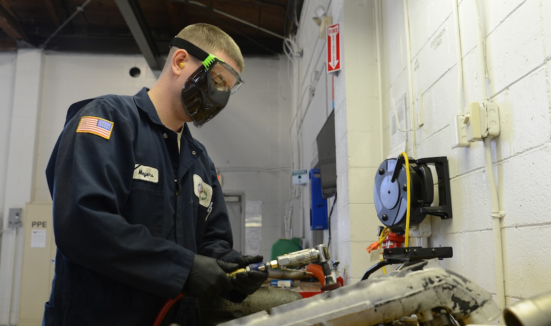 Senior Airman Aaron Myers, 627th Logistics Readiness Squadron vehicle maintenance technician, cleans an intake manifold for a refrigerated truck March 30, 2017, at Joint Base Lewis-McChord, Wash. McChord vehicle maintenance technicians are responsible for performing scheduled maintenance on 15 to 20 vehicles monthly. (U.S. Air Force photo/Senior Airman Jacob Jimenez)