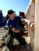 Airman 1st Class Tyler Robinson, a power production journeyman assigned to the 28th Civil Engineer Squadron, helps install low-barring walls in a Habitat for Humanity home training in Rapid City, S.D., March 23, 2017. The 28th CES conducts monthly training with Habitat for Humanity to improve their construction skills, while also giving back to the local community. (U.S. Air Force photo by Airman 1st Class Donald C. Knechtel)