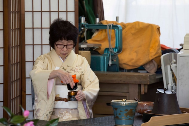 Nakamoto, a Japanese local, demonstrates a traditional Japanese tea ceremony during cultural exchange at Tsuzu Elementary School at Iwakuni City, Japan, March 11, 2017. During the event, a cooking class was held to teach people how to make common Japanese dishes. The event, which brought Americans and Japanese together, taught residents from MCAS Iwakuni about Japanese culture. (U.S. Marine Corps photo by Lance Cpl. Gabriela Garcia-Herrera)