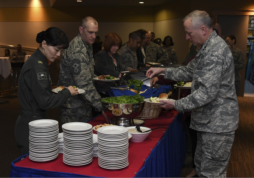 Distinguished guests get lunch during the Women's History Month Luncheon at Osan Air Base, Republic of Korea, March 30, 2017. The luncheon highlighted important moments in history and the progress of women in all facets, particularly in the military. (U.S. Air Force photo by Airman 1st Class Gwendalyn Smith)