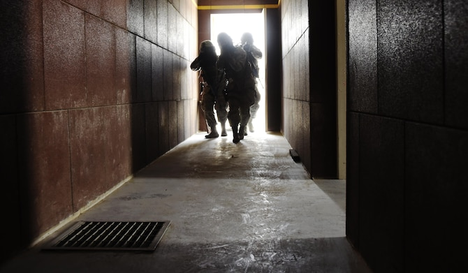 U.S. Air Force patrolmen with the 379th Expeditionary Security Forces Squadron breach the threshold of an active shooter training facility at Al Udeid Air Base, Qatar, March 30, 2017. Active shooter incident response training is conducted often for 379th ESFS Airmen due to the unpredictable nature of active shooters. (U.S. Air Force photo by Senior Airman Cynthia A. Innocenti)