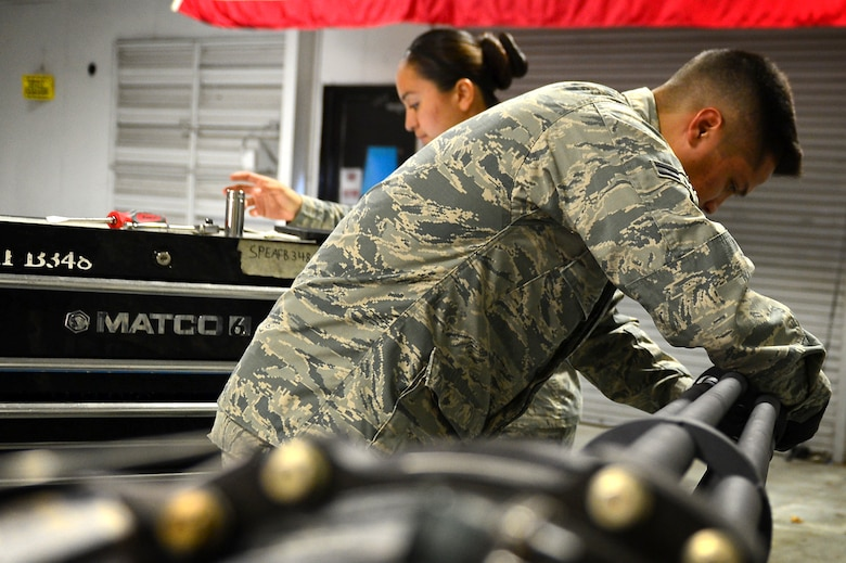 U.S. Air Force Airman 1st Class Zachary Flores, 20th Equipment Maintenance Squadron aircraft armament systems technician, performs an operations security (OPSEC) check on an M-61A1 20 mm multi-barrel cannon at Shaw Air Force Base, S.C., March 29, 2017. Armament flight Airmen ensure all machinery entering the facility is inspected and remains in compliance with all OPSEC measures. (U.S. Air Force photo by Airman 1st Class Christopher Maldonado)