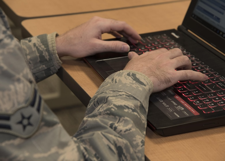 A1C David Welsh, a Fusion Analyst assigned to the 135th Intelligence Squadron, works on his laptop March 24, 2017 at Warfield Air National Guard Base, Middle River, Md. Welsh is the April 2017 Spotlight Airman. (U.S Air National Guard photo by SrA Enjoli Saunders/RELEASED)