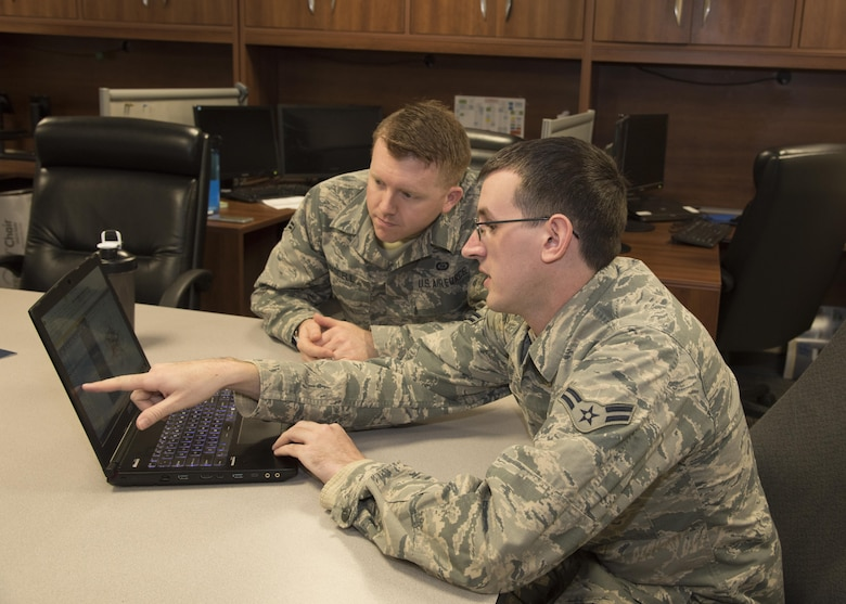 A1C David Welsh, a Fusion Analyst assigned to the 135th Intelligence Squadron, works with a fellow member March 24, 2017 at Warfield Air National Guard Base, Middle River, Md. Welsh is the April 2017 Spotlight Airman. (U.S Air National Guard photo by SrA Enjoli Saunders/RELEASED)