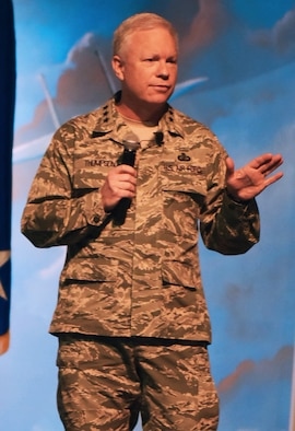Lt. Gen. John Thompson, Air Force Life Cycle Management Center commander, speaks to a packed crowd during the Program Executive Officer Review and Outlook at the Museum of Aviation, March 23. (U.S. Air Force photo by RAYMOND CRAYTON, JR.)
