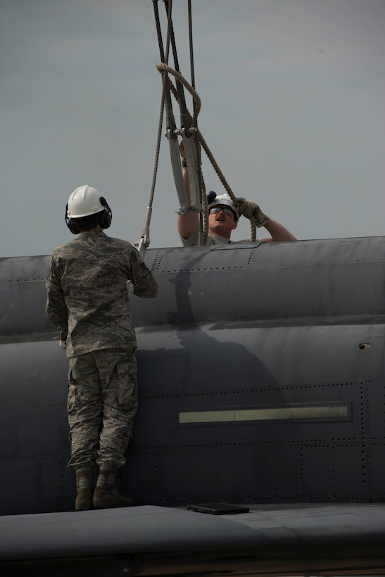 U.S. Air Force Senior Airman Chadon Bowman, 39th Maintenance Squadron transient alert, Crash Damaged Disabled Aircraft Recovery (CDDAR) team member, pulls on a safety rope while standing on a decommissioned Turkish air force F-4 Phantom during a training exercise March 30, 2017, at Incirlik Air Base, Turkey. The primary objective of the CDDAR mission is to quickly and safely remove immobile aircraft and return the runway to operational status. (U.S. Air Force photo by Airman 1st Class Devin M. Rumbaugh)