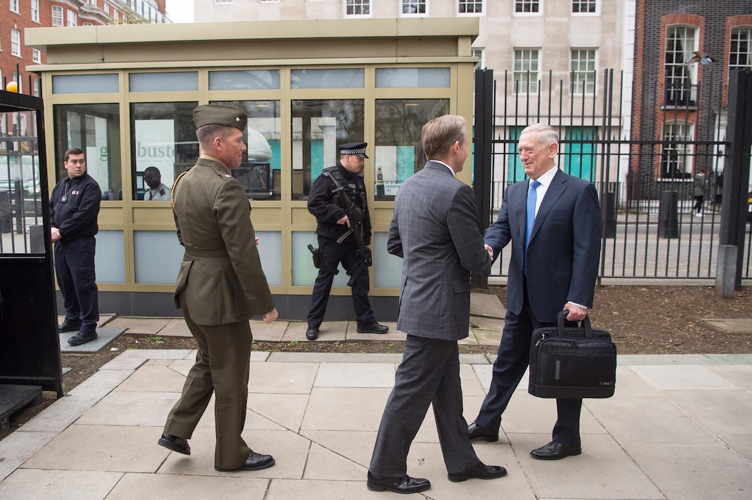 Defense Secretary Jim Mattis shakes hands with U.S. Ambassador to the United Kingdom Lewis Lukens.