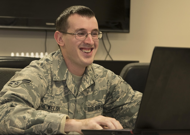 A1C David Welsh, a Fusion Analyst assigned to the 135th Intelligence Squadron, works on his laptop computer March 24, 2017 at Warfield Air National Guard Base, Middle River, Md. Welsh is the April 2017 Spotlight Airman. (U.S. Air National Guard photo by SrA Enjoli Saunders/RELEASED)