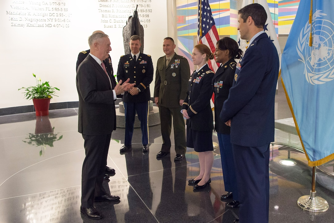 Defense Secretary Jim Mattis speaks with service members during a visit to the U.S. Mission to the United Nations.