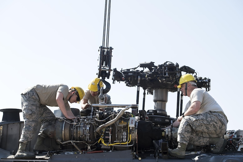 Airmen from the 41st Helicopter Maintenance Unit install an engine to a HH-60G Pave Hawk, March 22, 2017, at Moody Air Force Base, Ga. The 41st HMU is responsible for Moody's Pave Hawk fleet. Through innovation and preventative maintenance, they ensure each of their 13 Pave Hawks receive the upkeep needed to accomplish the mission. (U.S. Air Force photo/Airman 1st Class Janiqua P. Robinson)