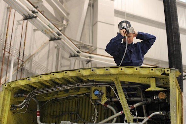 U.S. Air Force Senior Airman Timothy Thompson, 19th Maintenance Squadron Fuel Systems journeyman, prepares to enter a mock fuel tank March 29, 2017, at Little Rock Air Force Base, Ark. It's the team's responsibility to make repairs after a fuel leak is suspected. (U.S. Air Force photo by Airman 1st Class Grace Nichols)