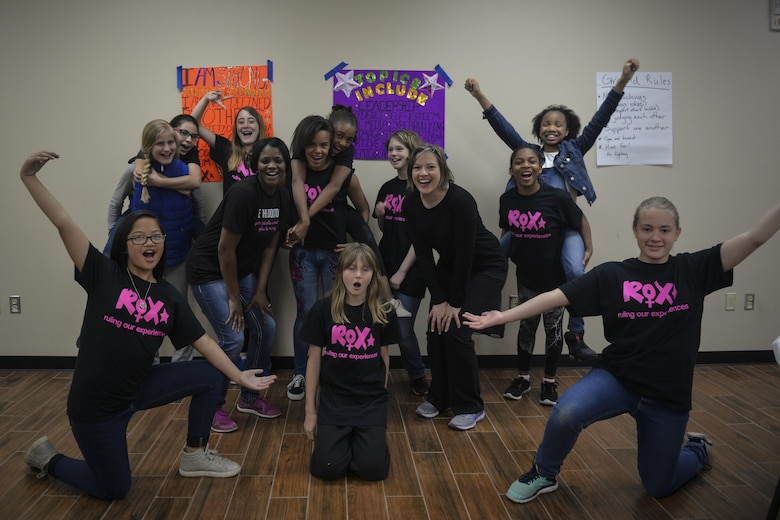 Girls celebrate learning the basics of self-defense March 28, 2017 at Cannon Air Force Base, N.M. The class was part of a ROX (ruling our experiences) mini-camp designed to teach educate and empower school-age girls. (U.S. Air Force photo by Senior Airman Shelby Kay-Fantozzi/released)