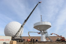 Technicians from the Tobyhanna Army Depot secure a communications dish to an Air Force Wideband Enterprise Terminal located at Offutt Air Force Base, Neb., Feb. 14, 2017. Air Force Wideband Enterprise Terminals located at Offutt Air Force Base, Neb. These terminals are among approximately 90 joint systems used worldwide to communicate and transfer information across the Global Information Grid. (U.S. Air Force photo by Zachary Hada)