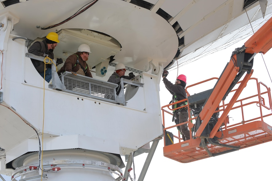 Technicians from the Tobyhanna Army Depot, Pennsylvania secure a communications dish to an Air Force Wideband Enterprise Terminal located at Offutt Air Force Base, Neb., Feb. 14, 2017. Tobyhanna Army Depot is a recognized leader in providing World-Class Logistics Support for Command, Control, Communications, Computers, Intelligence, Surveillance and Reconnaissance (C4ISR) Systems across the Department of Defense. (U.S. Air Force photo by Zachary Hada)
