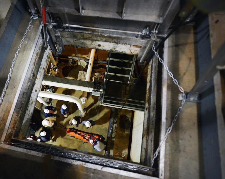 A group of Corps employees from various locks and dams throughout the Nashville District use a Tripod Rescue system to hoist 30 feet and simulate rescuing an injured worker from a permitted confined space at the Center Hill power plant during a permitted confined space training class March 16, 2017.