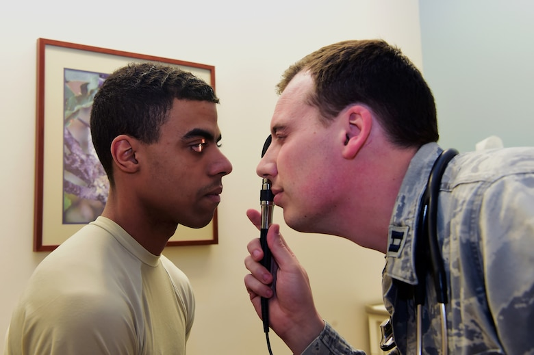 Capt. (Dr.) Ryan Frank, 460th Medical Group Doctor of Osteopath, performs an exam on Airman 1st Class Devante Wise, 460th MDG aerospace medical technician, March 30, 2017 at the Buckley Clinic in Aurora, Colo. Frank is part of the team of physicians at the 460th MDG who are being shown appreciation for National Doctor's Day observed annually on March 30.